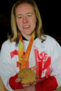 Lora holds her Paralympic Gold medal from Rio 2016