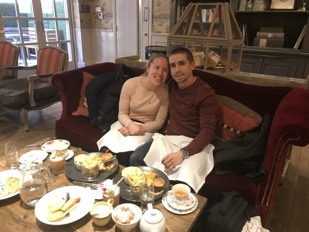 Lora and Neil sat together ready to eat afternoon tea