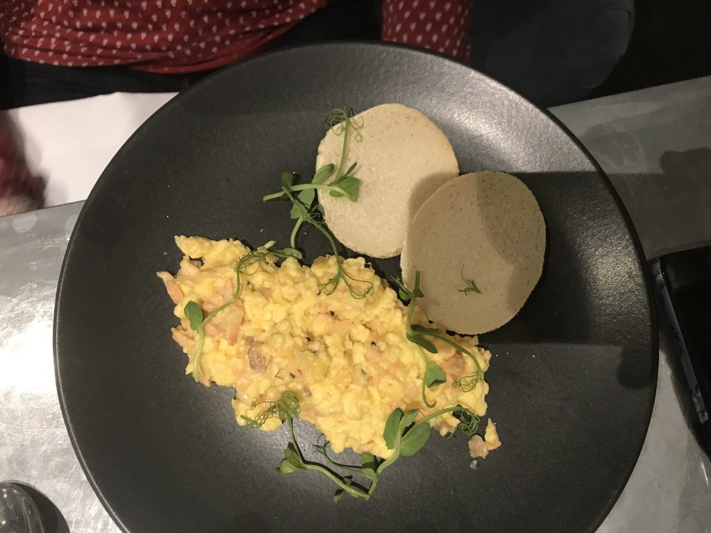 Scrambled eggs with smoked salmon and a toasted muffin