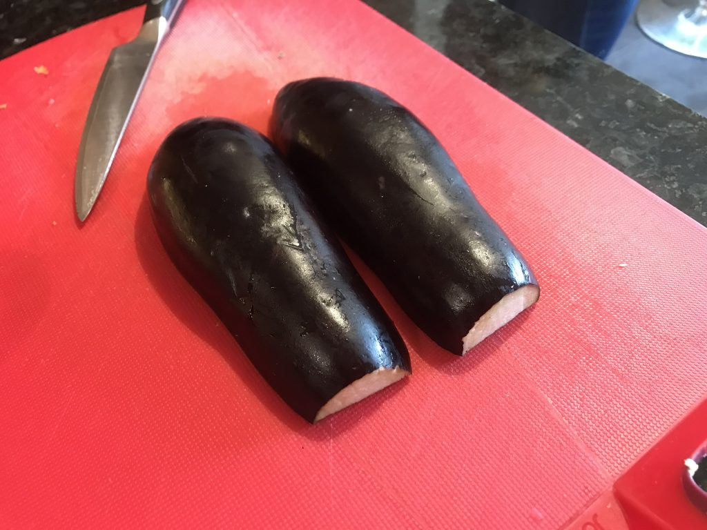 Aubergine sliced in half
